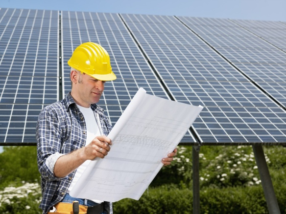 fotosearch_electrician-standing-solar_k3800204_SMALL